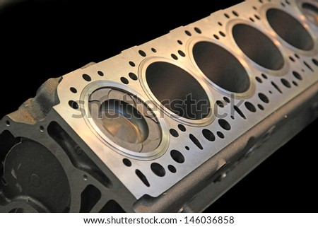 Part of car engine in a rugged aluminum enclosure - stock photo