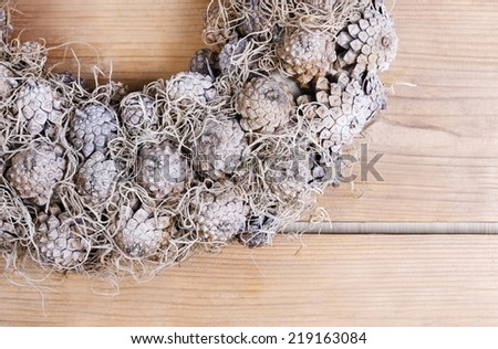 Part of christmas door wreath on wooden table, copy space - stock photo