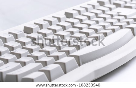 Part of computer keyboard on white - stock photo