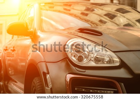 Part of contemporary luxury black car - stock photo