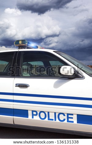 Part of cop car with special photographic processing - stock photo