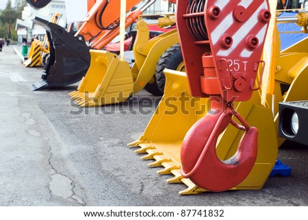 Part of crane on the exhibition background of heavy industrial machinery - stock photo