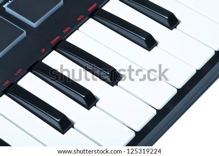 part of digital midi keyboard, close up - stock photo