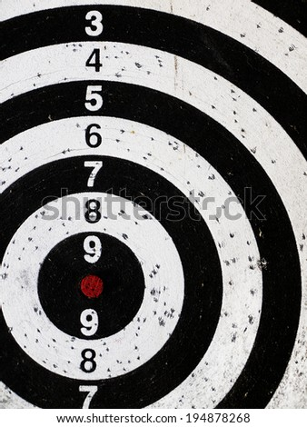 Part of drilled dartboard close up - stock photo