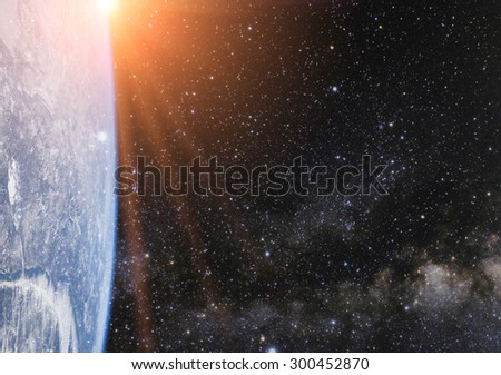 Part of earth planet in sun rays. Elements of this image are furnished by NASA - stock photo