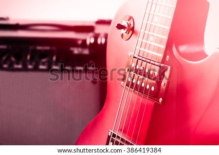 Part of electric guitar on wooden background. Old style. - stock photo