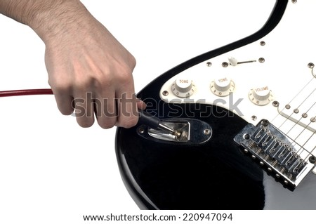Part of  Electric Guitar Plugin jack  on isolated white background - stock photo