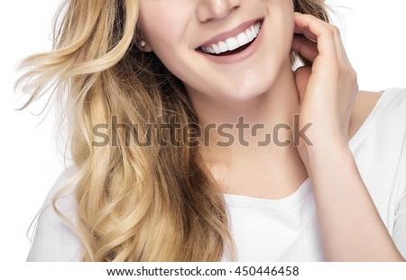 Part of face. Beautiful young blond smiling woman with clean face. - stock photo