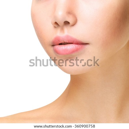 Part of face,young woman close up isolated on white.