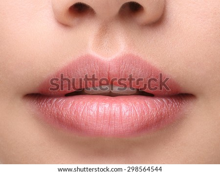 Part of face,young woman close up. Sexy plump lips without makeup - stock photo