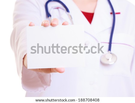 Part of female body in white lab coat. Doctor or nurse with stethoscope holding blank copy space card isolated. Medical person for health insurance. - stock photo