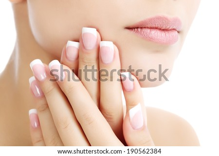 Part of female face and hands, white background, copyspace  - stock photo