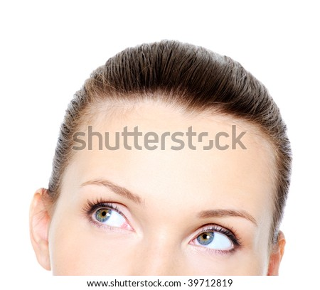 Part of female head with rolling eyes - isolated on white