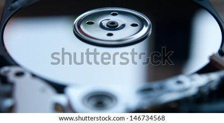 Part of hard disk of computer. Shallow DOF, close up - stock photo