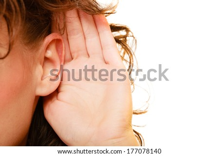 Part of head woman female hand to ear listening isolated on white background. Gossip - stock photo