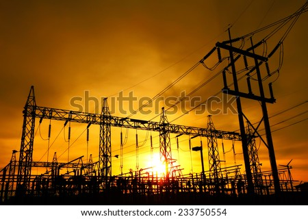 Part of high voltage substation at sunset background. - stock photo