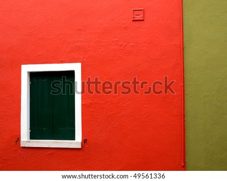 Part of house in coral, olive, white and green colors