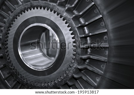 Part of industrial machines in black and white.