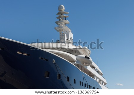 Part of large anchored ship or cruise against blue sky - stock photo