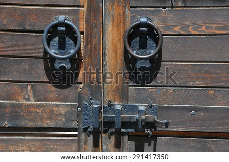 Part of medieval gate with locking mechanism - stock photo