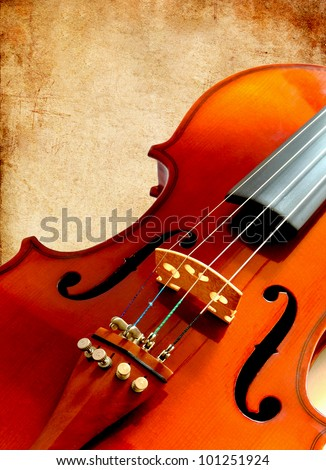 Part of new violin on grunge paper background - stock photo