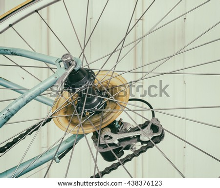 Part of old bicycle wheel, derailleur, and chain (vintage effect)