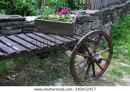 Part of old cart and flowers in the flower box in Bulgaria