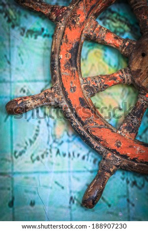 Part of old ship's wheel hanging on a wall - stock photo