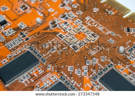 part of orange electronic board - close up - stock photo