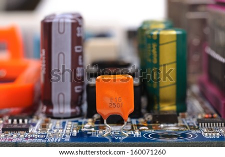 Part of PC mainboard with electronic components. Close-up with selective focus and shallow DOF. - stock photo