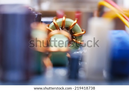 Part of PC mainboard with electronic components. Close-up with shallow DOF. - stock photo