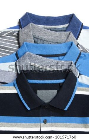 Part of pile of Five man polo clothes - stock photo