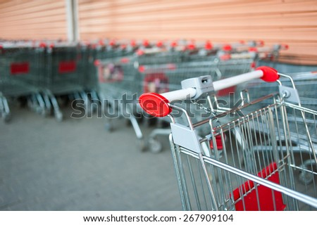 Part of shopping cart with the stack of carts on the background - stock photo