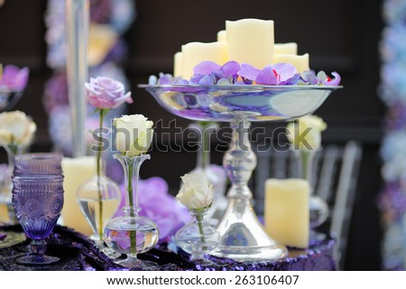 Part of stylish indoor wedding party or date interior with flowers and candles