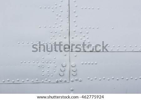 Part of the aircraft, aluminum sheet with rivets and hatch