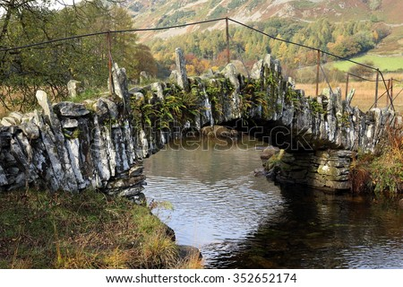 Part of the ancient Slater's Bridge in Little Langdale, Cumbria, England an old crossing of the River Brathay that is a draw for tourists and walkers in the Lake District National Park. - stock photo