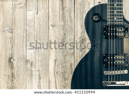 Part of the blue electric guitar on wooden background. A place for writing of the text - stock photo