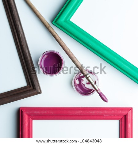Part of the frames, acrylic paint and paint brush. - stock photo