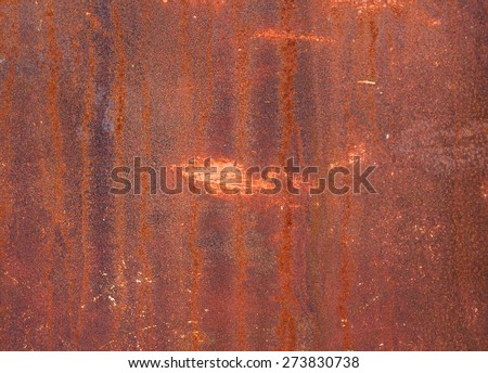 Part of the old-painted iron sheet with rust stains. textural composition