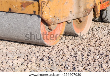 Part of the old road rink prepares the roadway for asphalt - stock photo