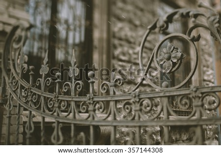part of the old wrought iron gate,19 century,tilt-shift - stock photo