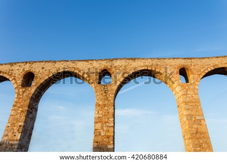 Part of the Roman aqueduct, known as Arches, in Halkida, Greece - stock photo