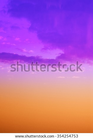 Part of the sky with clouds in the abstract pastel shades of purple, pink,