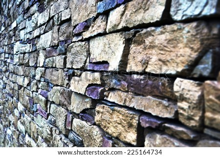 Part of the stone wall. Grey brick wall background texture. - stock photo