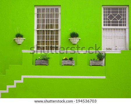 Part of the wall of the house. Porch. The front facade of the house. Bright colors. Green. Bo-Kaap. Malay Quarter. Cape Town. South Africa