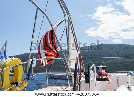 """Part of the yacht from the helm. Tivat, Montenegro - 26 April, 2016 Regatta """"Russian stream"""" in God-Katorskaya bay of the Adriatic Sea off the coast of Montenegro. - stock photo"""