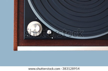 Part of vintage record player with wood finish top view isolated on cyan horizontal photo from above closeup