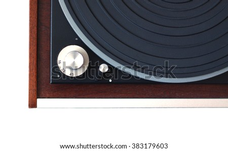 Part of vintage record player with wood finish top view isolated on white horizontal photo from above closeup