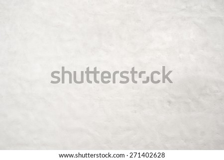 Part of white stucco wall texture background - stock photo