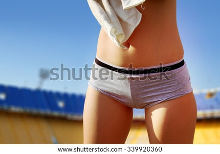 part of woman body in sport shorts - stock photo